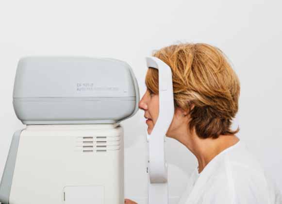 A lady taking an eye test