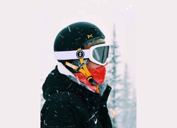 A person wearing dark-colored ski goggles