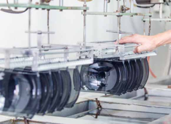Ski goggle lenses in a production line
